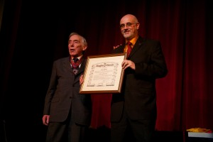 Clive Receiving His MIMC Certificate from President Jack Delvin